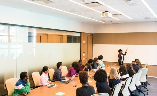 Woman leading presentation in conference room